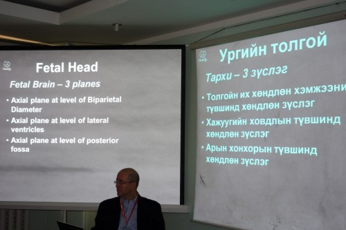 Dr. David Berck gives a lecture. The students can look at the slides either in English (left) or in Mongolian (right).